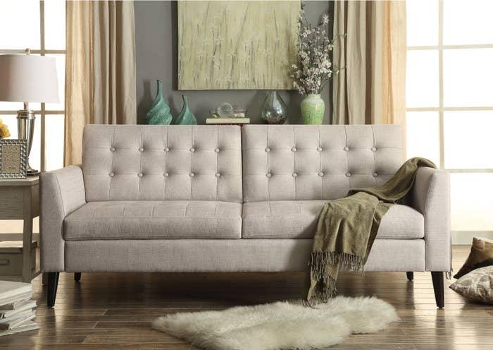 The tuxedo arm sofa in beige