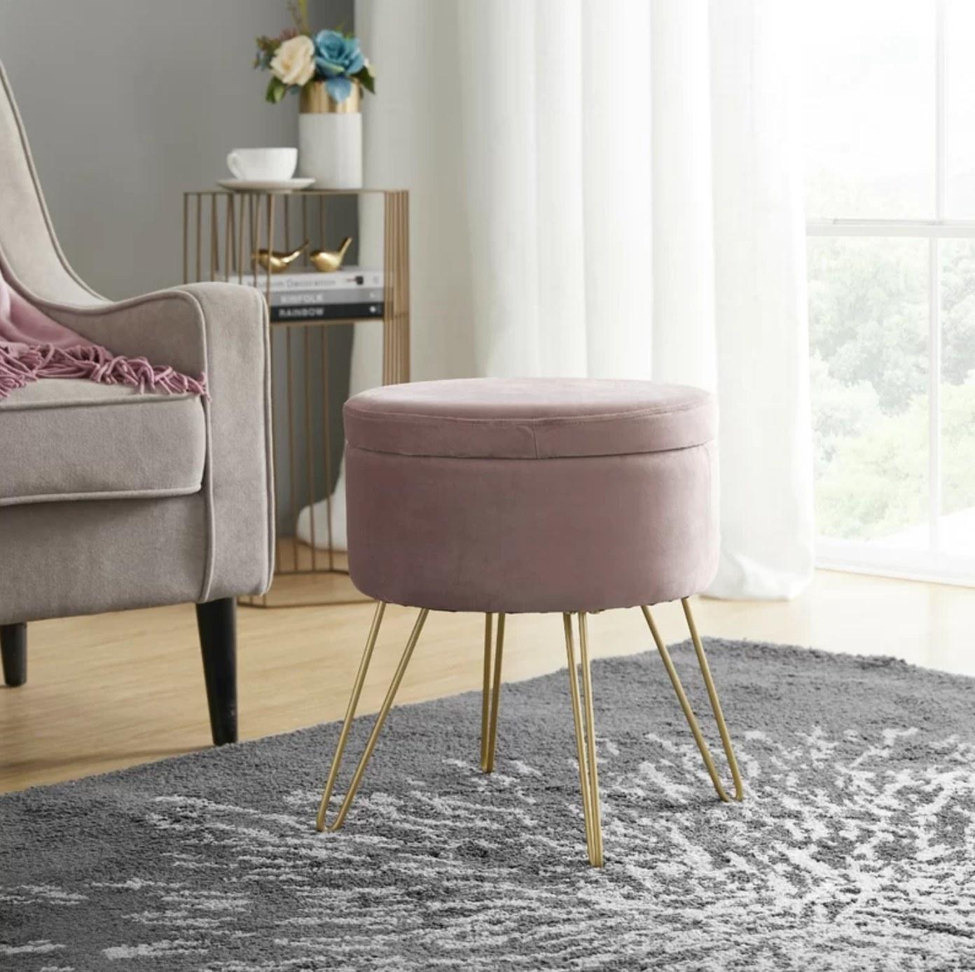 The velvet storage ottoman in blush