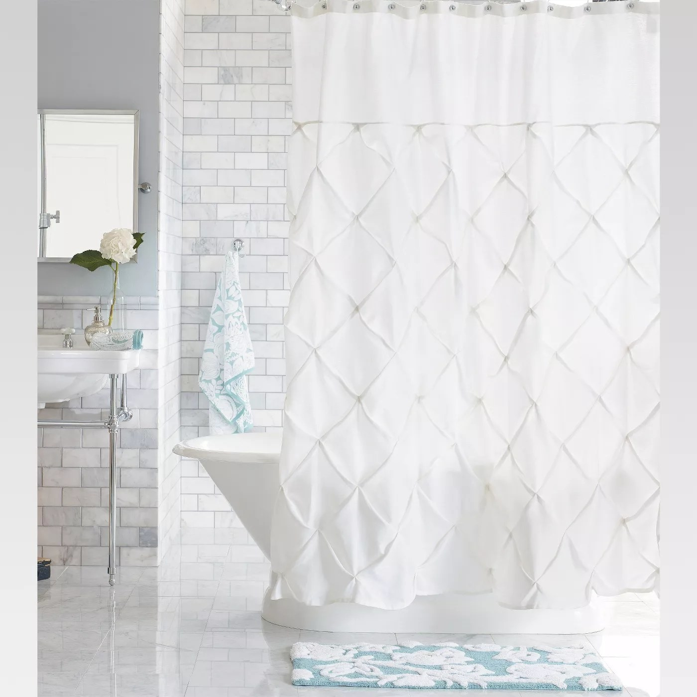 The white pleated shower curtain