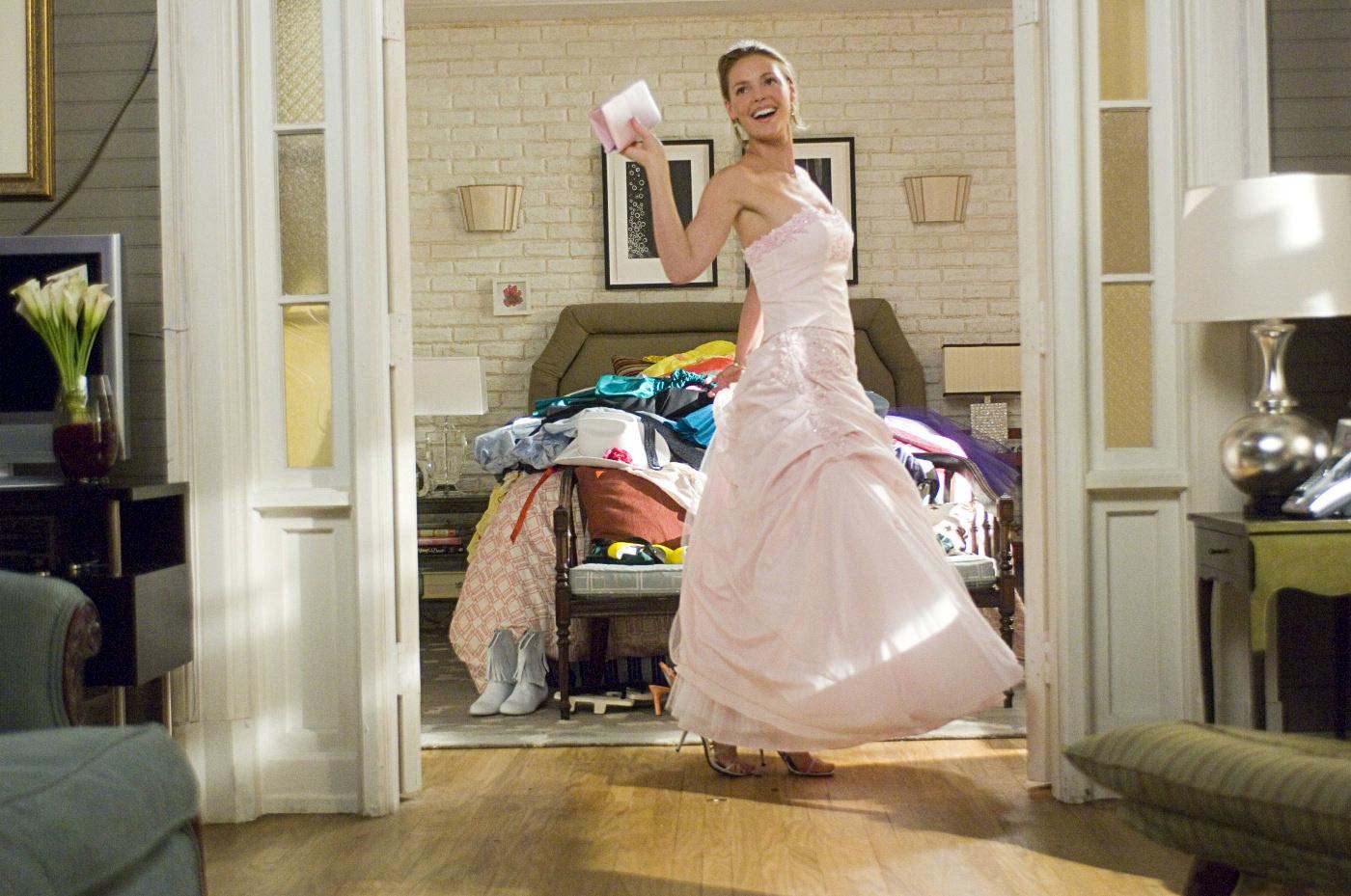 Jane wears a strapless pale pink ballgown