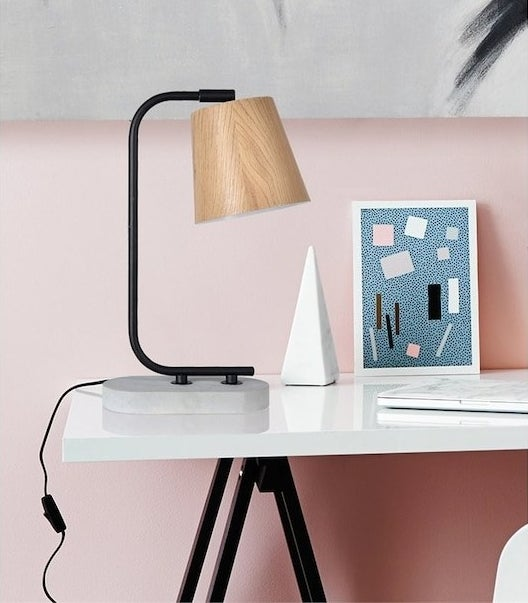 A table lamp on a desk