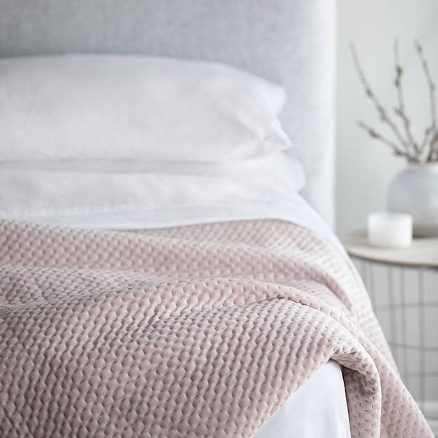 A cute cozy weighted blanket on a bed