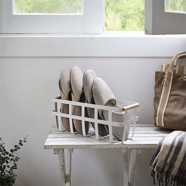 A basket with slippers in it