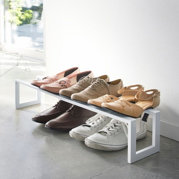 The shoe rack shelf with shoes on it