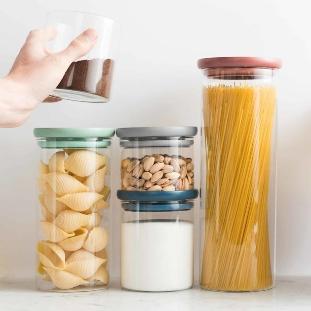 Five glass food storage containers with various ingredients stored in them