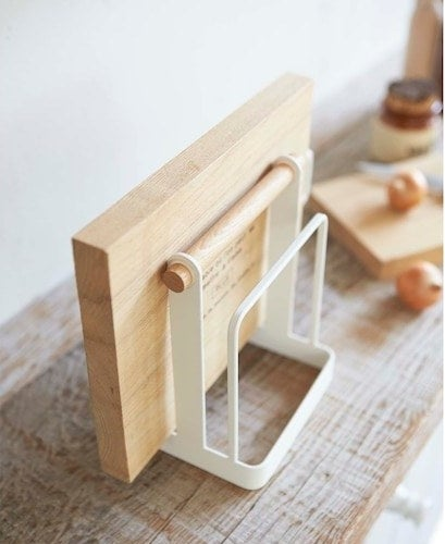 The cutting board stand with a cutting board in it