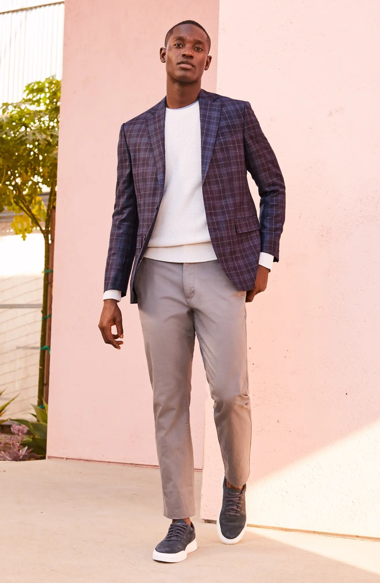 A model wearing the chinos in grey