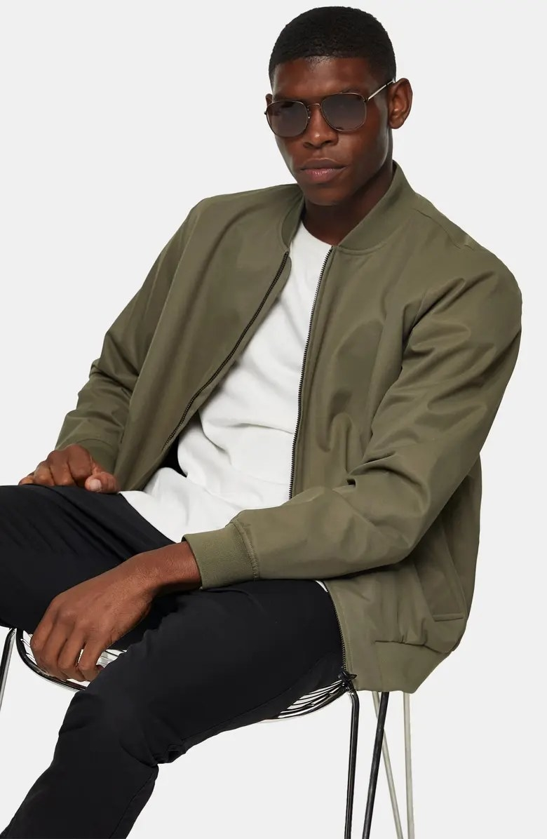 A model wearing the bomber in olive