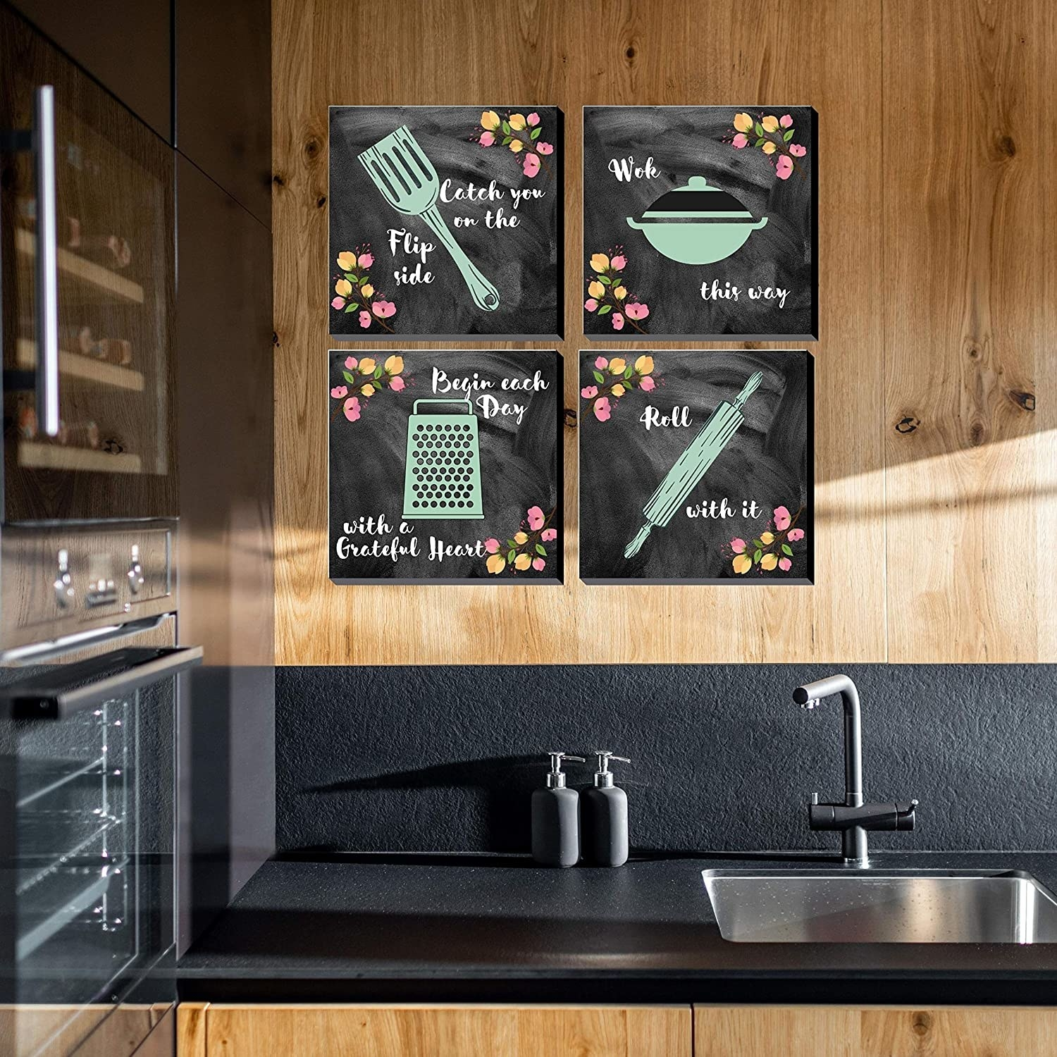 """4 chalkboard frames hung up on a kitchen wall. They have punny quotes on them like, """"Catch you on the flip side"""", """"Wok this way"""", """"Begin each day with a grateful heart"""", and """"Roll with it""""."""