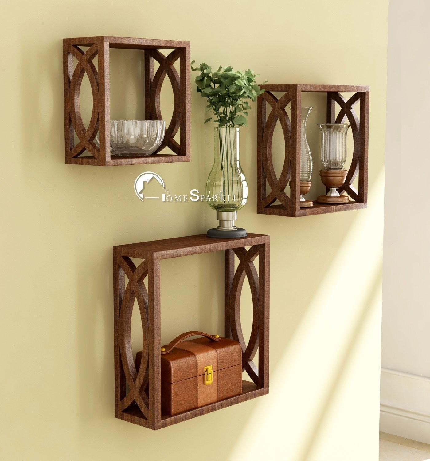 Cubical wooden shelves used to hold glass bowls, lamps, and a small trunk