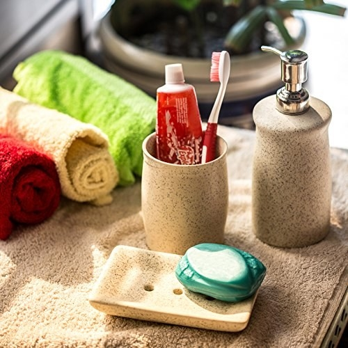 Textured beige ceramic soap dispenser, soap dish, and toiletry holder