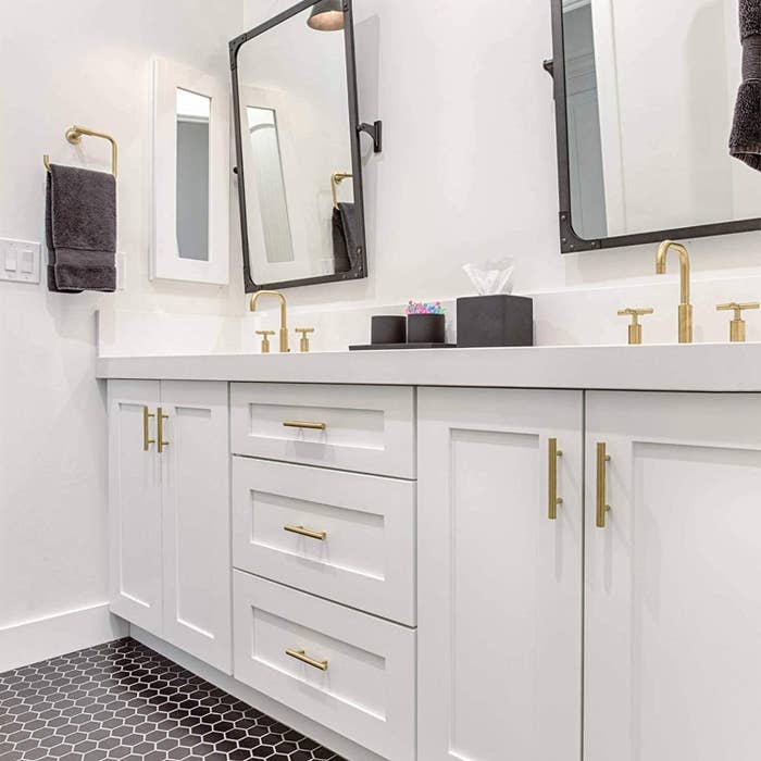 a bathroom dresser with the knobs installed