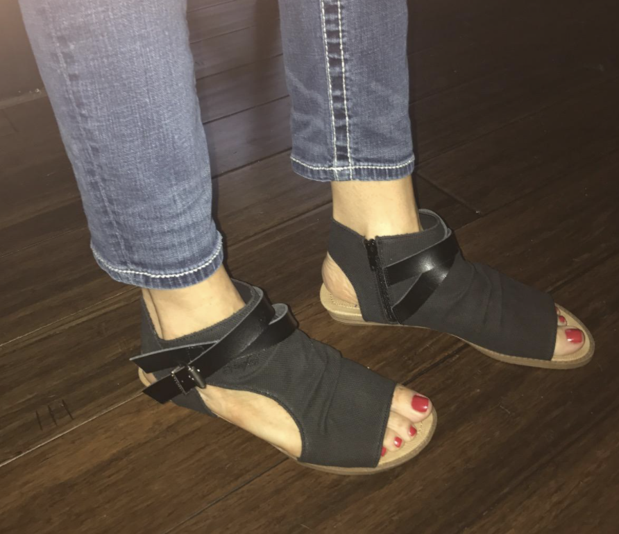 reviewer wearing the shoes in black