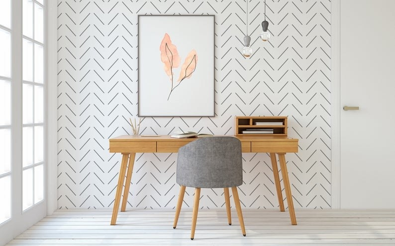A desk against a wall with the wallpaper