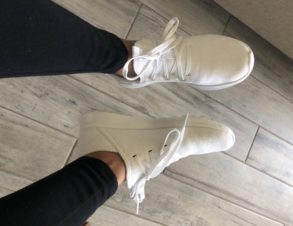 reviewer wearing cloudfoam sneakers in white
