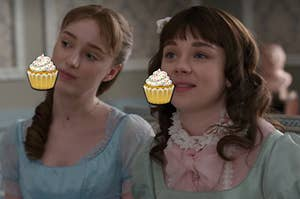 Daphne is on the left eating a cupcake emoji with Eloise on the right eating a cupcake emoji