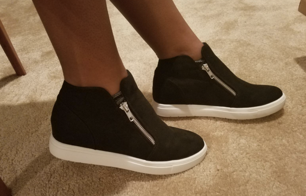 reviewer wearing hidden wedge sneakers
