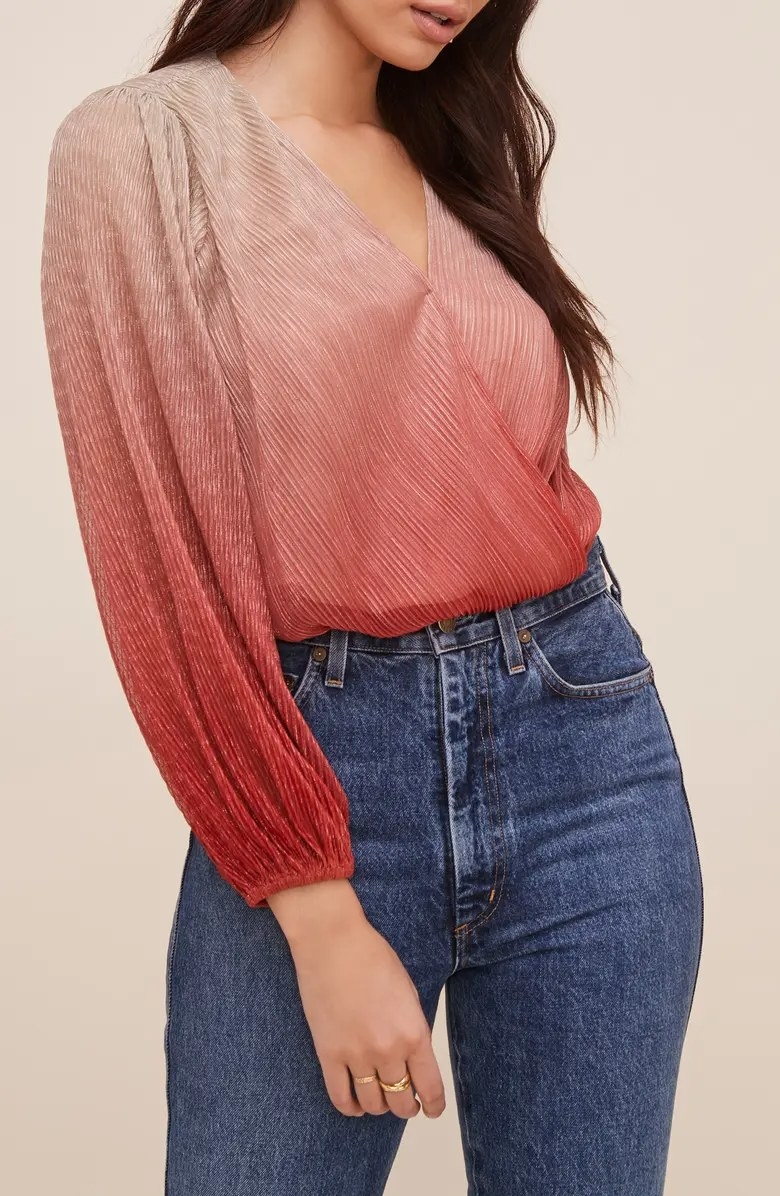 A close-up of the top worn by a model