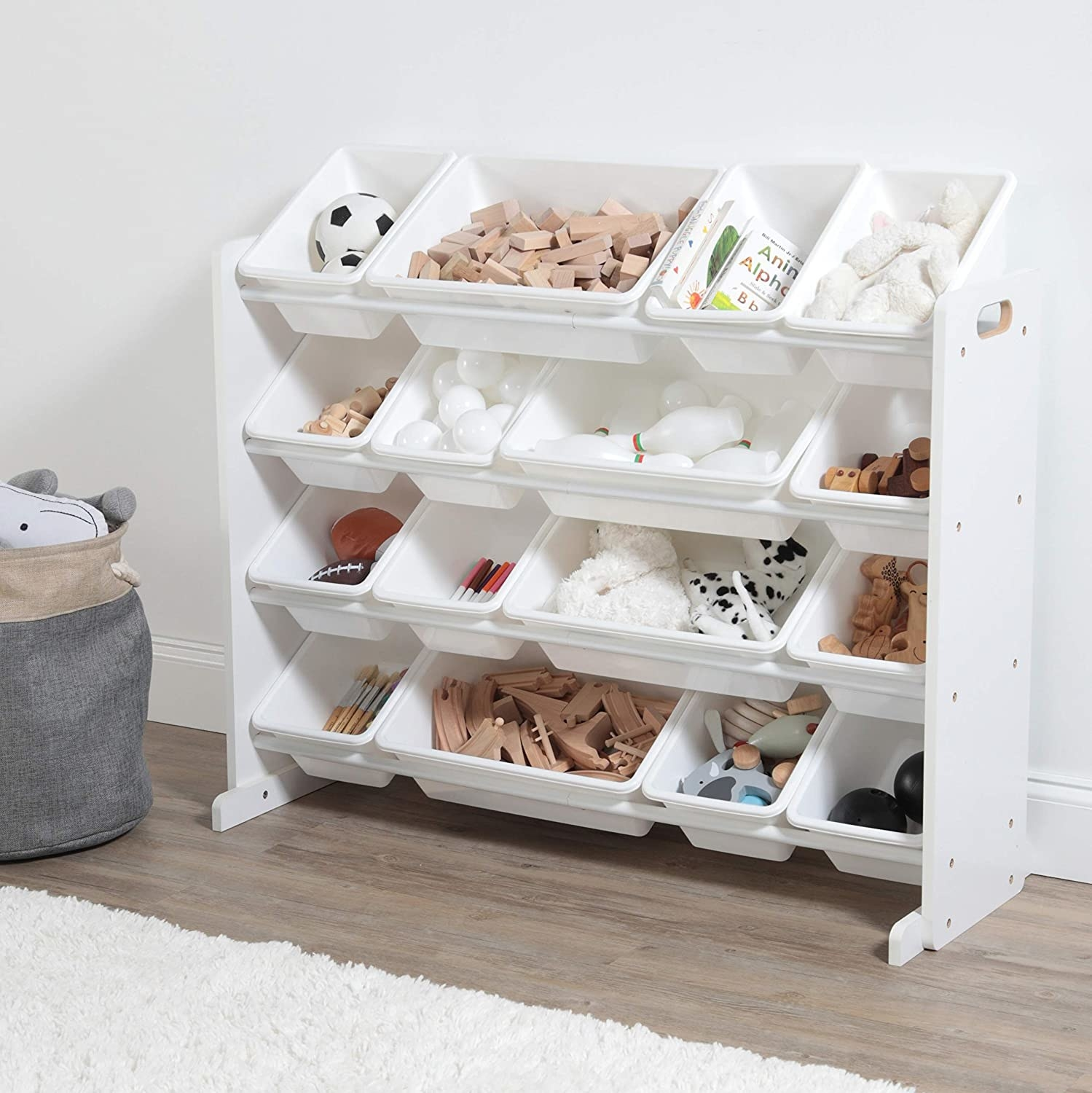 Minimalist white shelving with matching removable containers in varying sizes. It has four shelves.