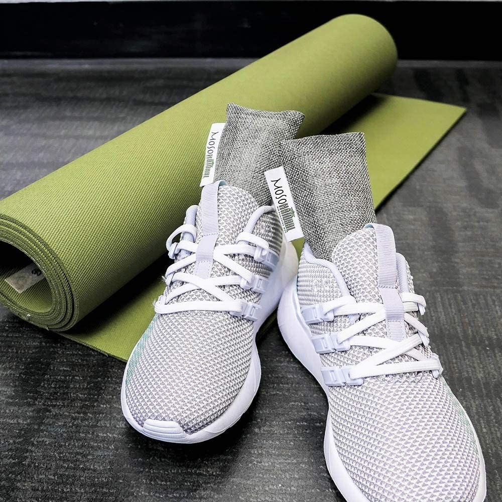 A pair of running shoes with air purifying bags in them
