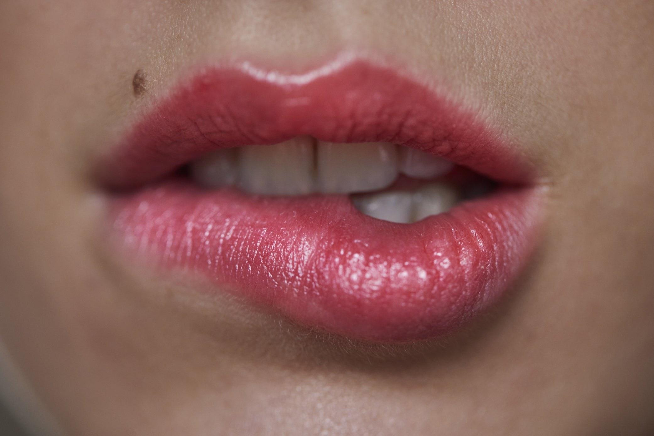 Someone biting their lip