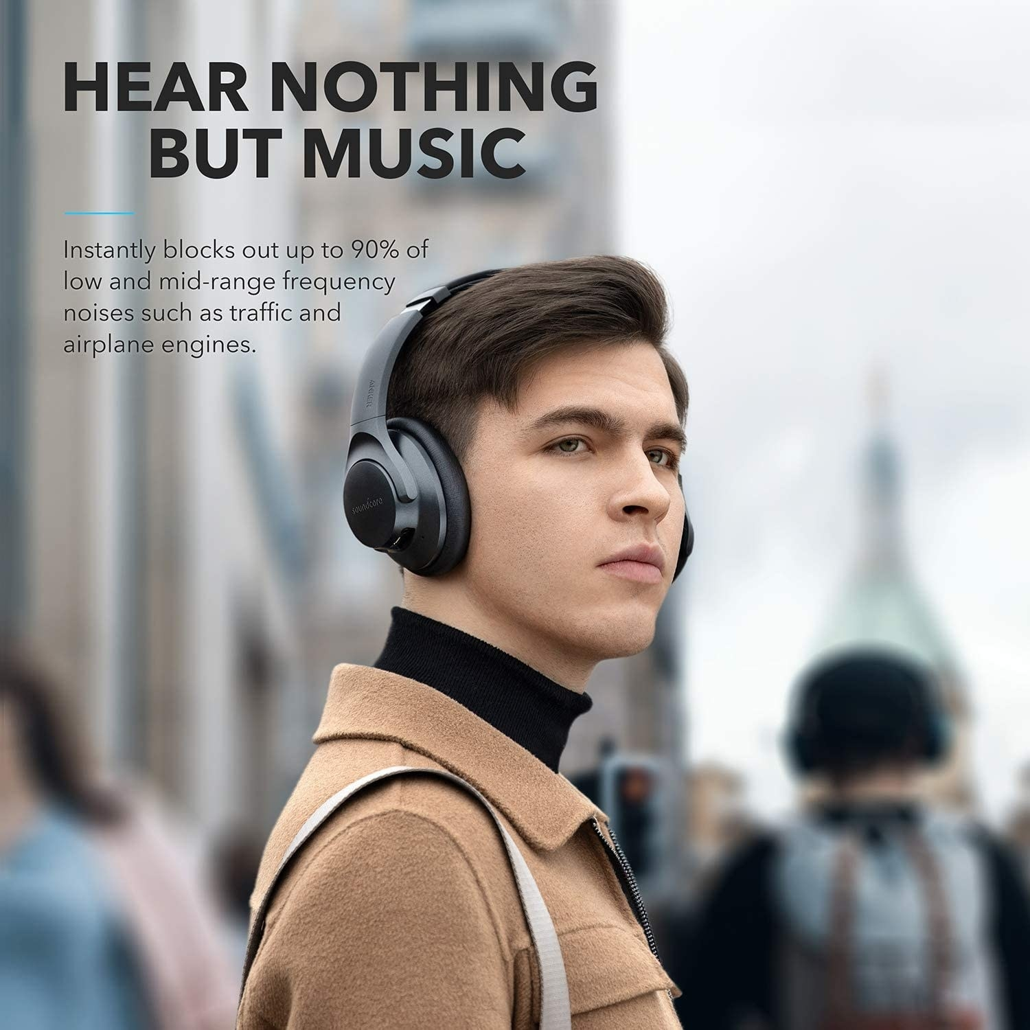 A person wearing the over-ear headphones