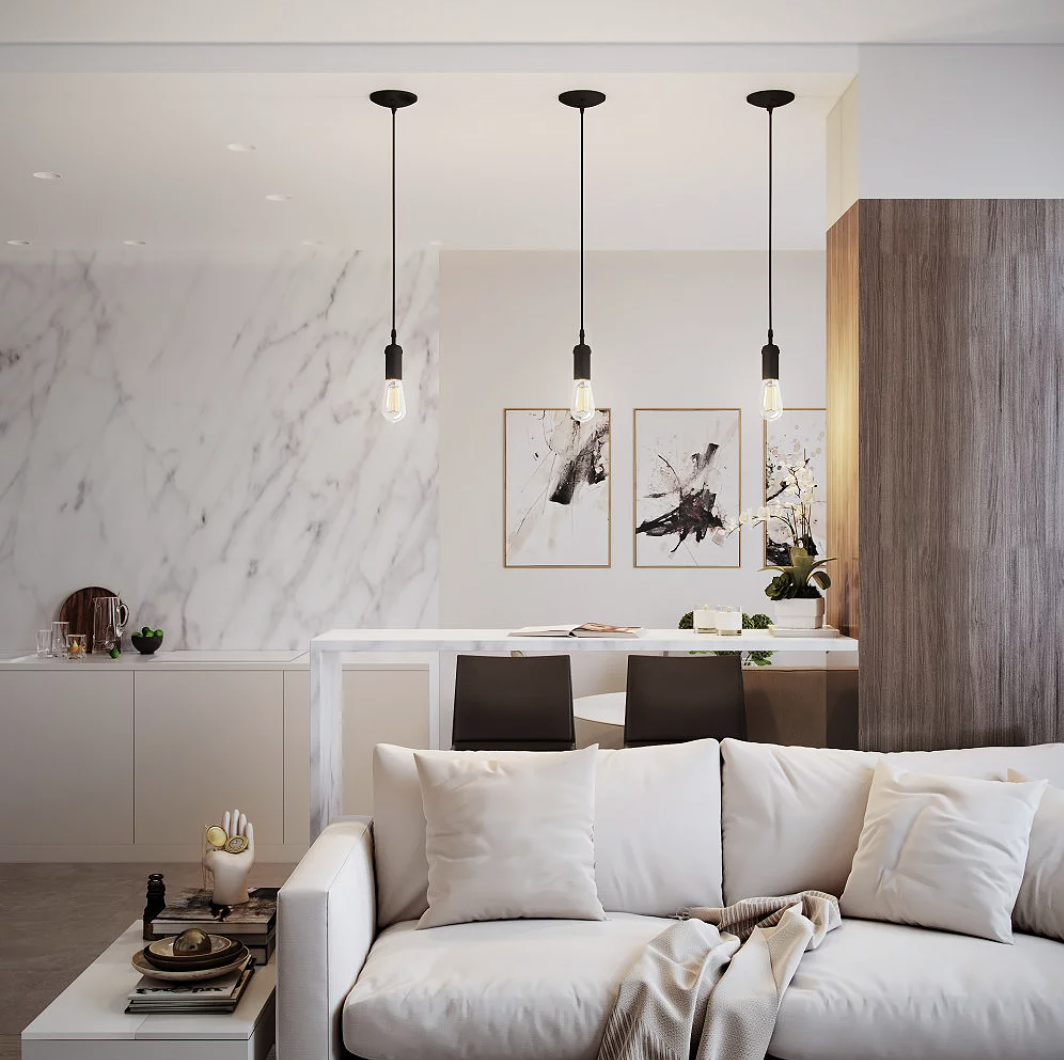 three of the pendant lights hanging over an island