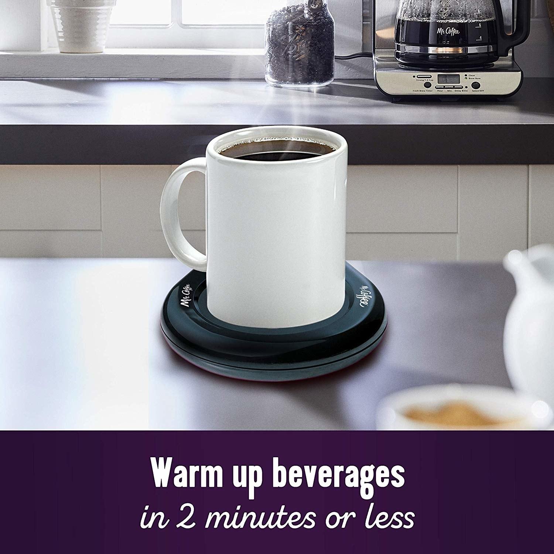 A ceramic mug warming on the mug warming device