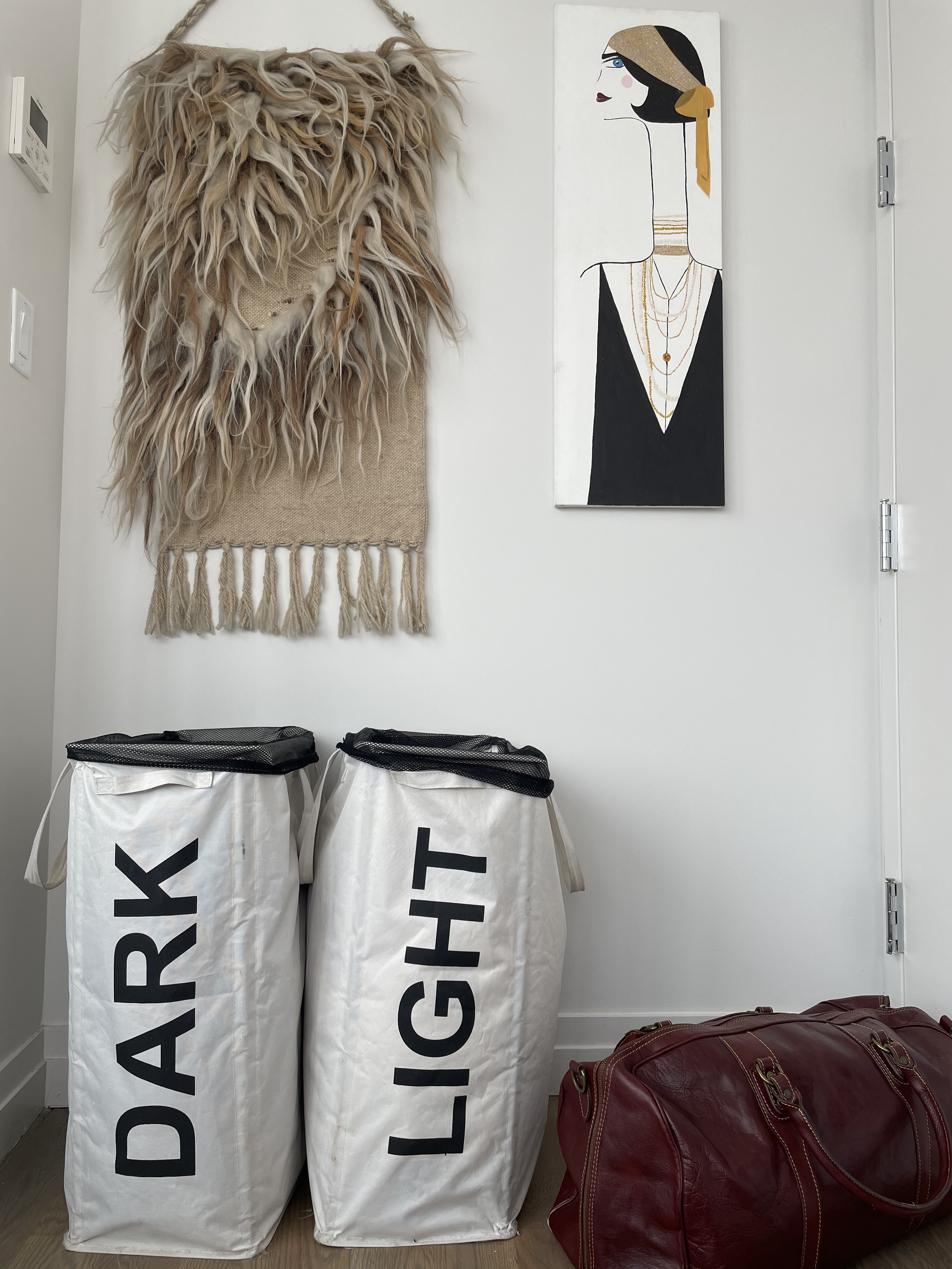"""Two cloth laundry hampers with handles and mesh bags inside. One says """"Dark"""" and the other """"Light"""""""