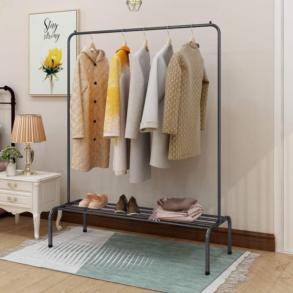 the rack with clothes and shoes