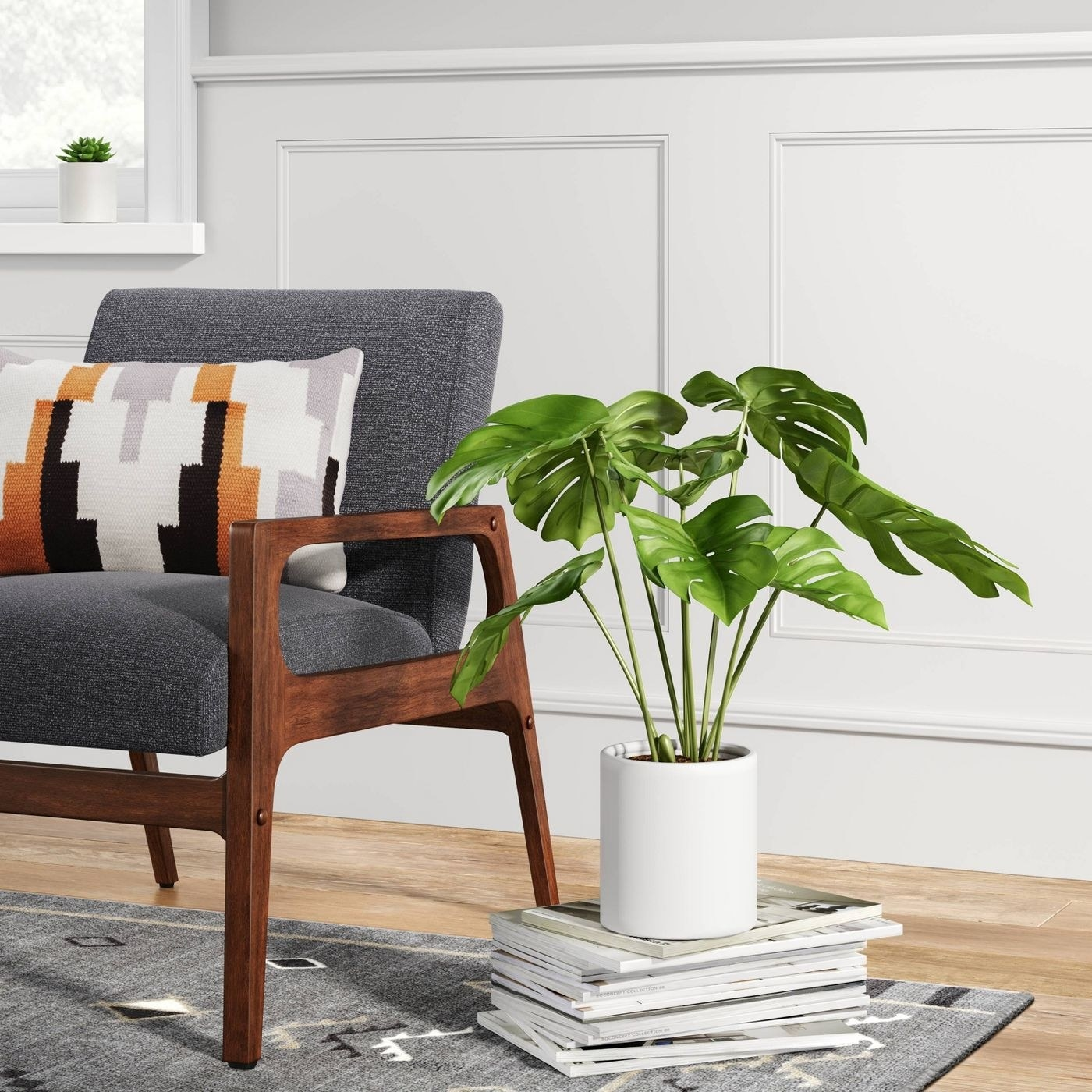 the artificial plant in a white pot next to an armchair, which it's about half the height of