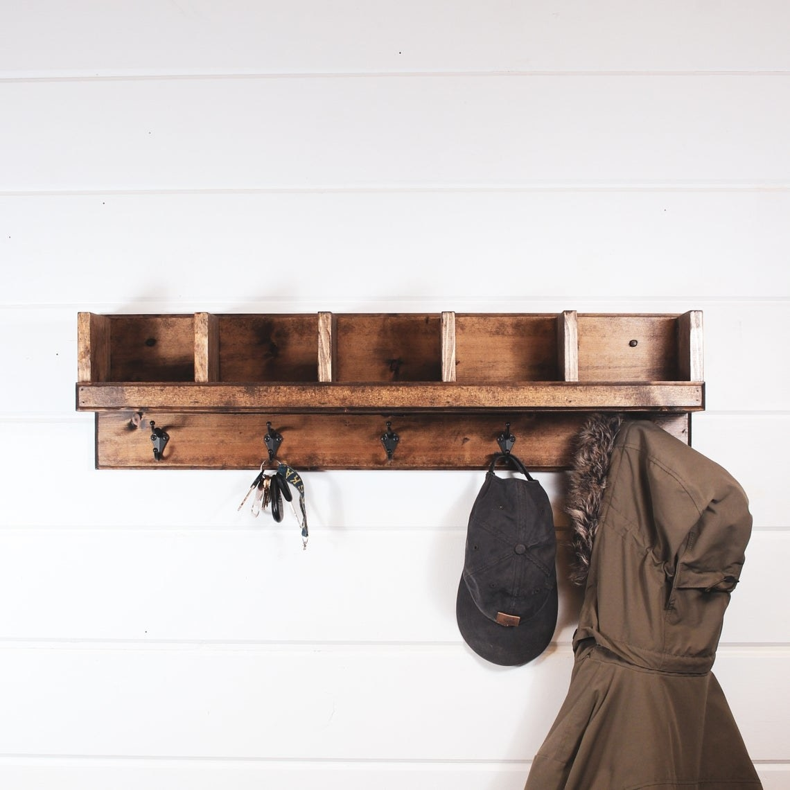 Wooden rectangular entryway storage shelf with five cubby holes and five hooks