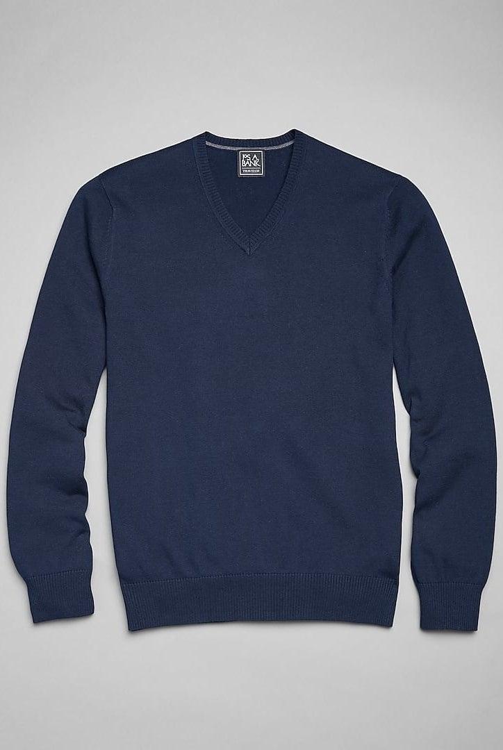 a blue v-neck sweater