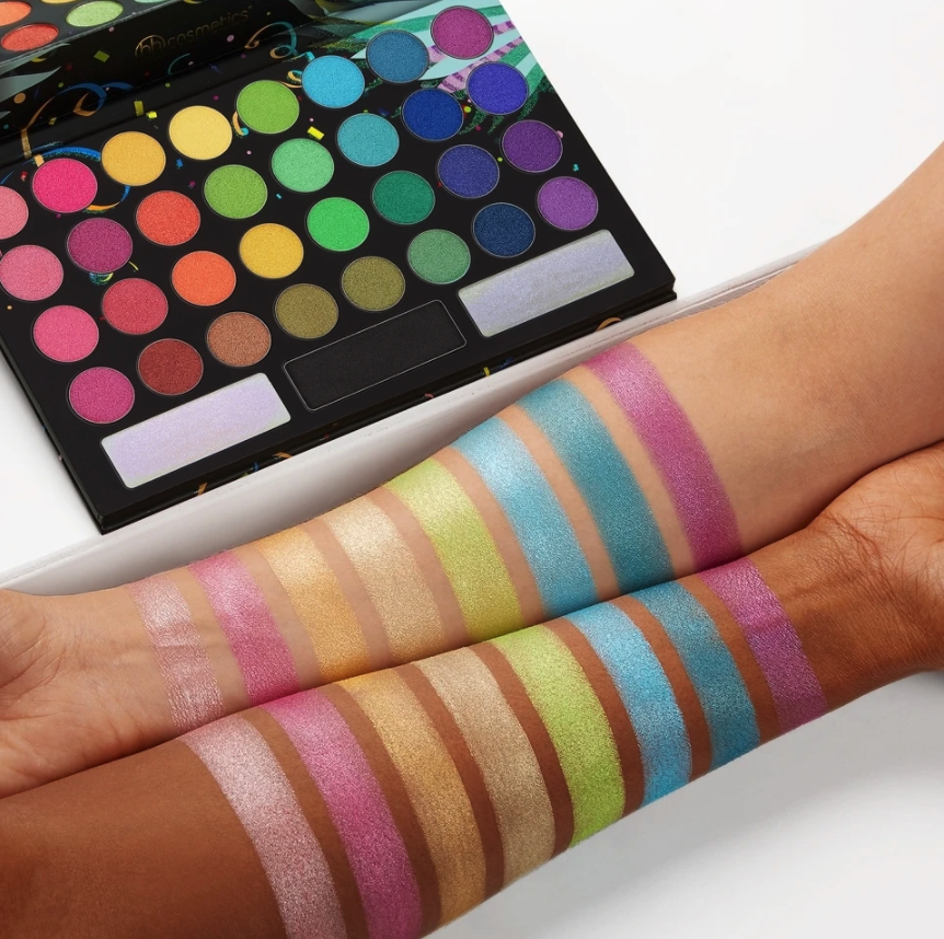 two arms with different skin tones swatching the vibrant palette with 35 colors