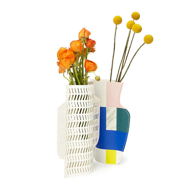the white cutout vase and colorful geometric vase