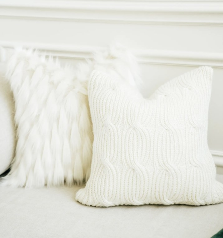 A white knit accent pillow