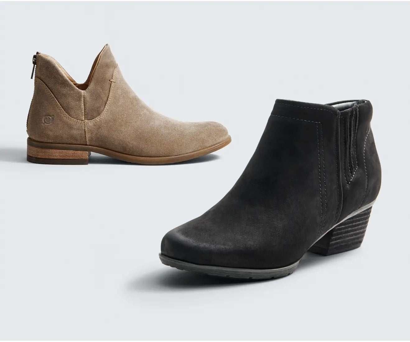 Two of the booties, on in brown and one in black