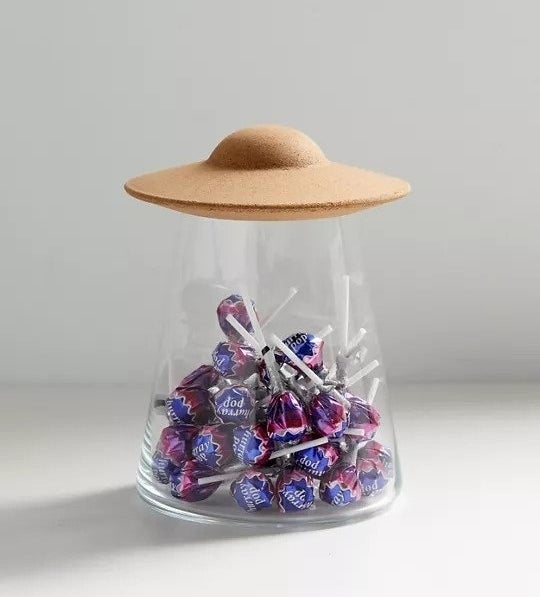 Glass and cork storage vase that looks like a UFO