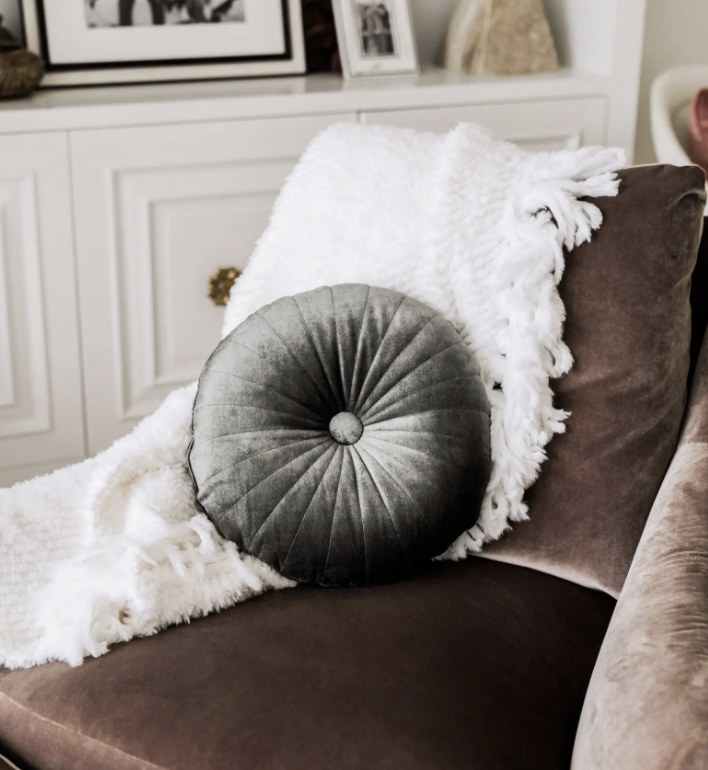 A round black velvet pillow