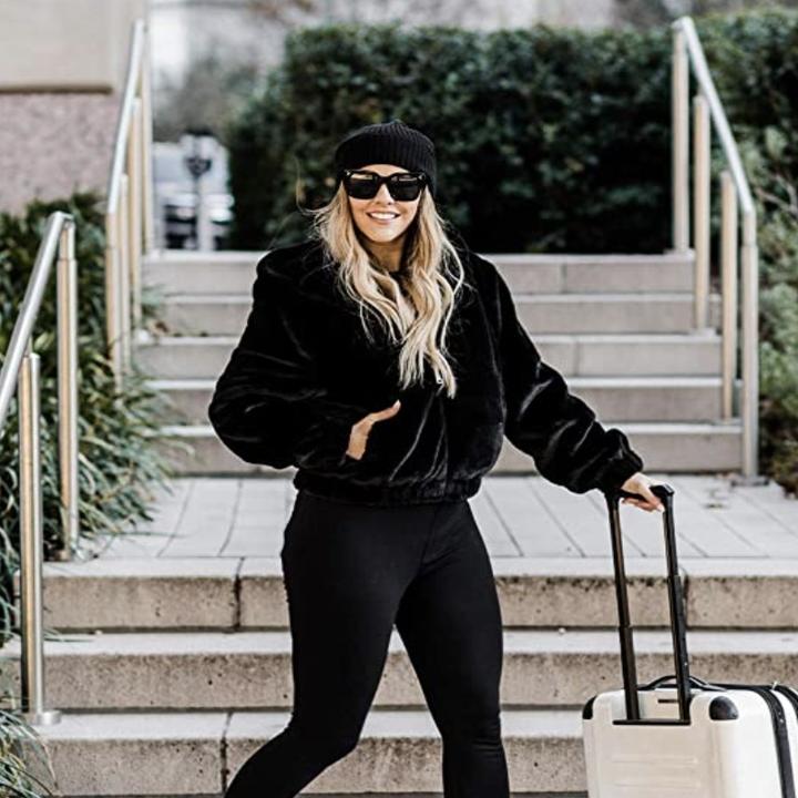 model wearing black beanie