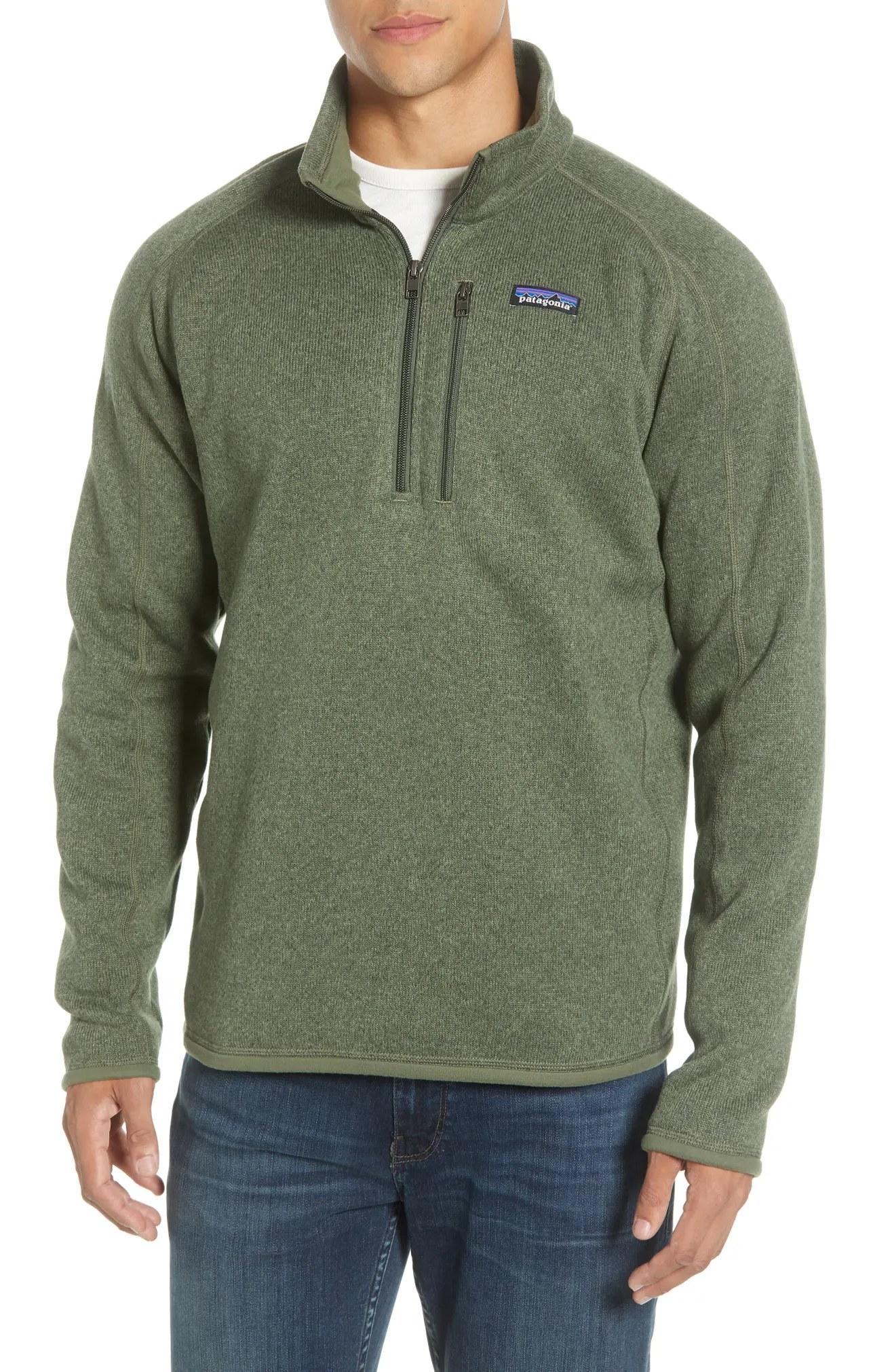 A close-up of the pullover sweater worn by a model