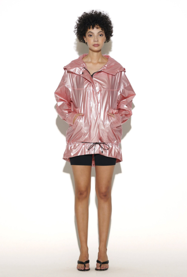 model wearing a rose gold windbreaker