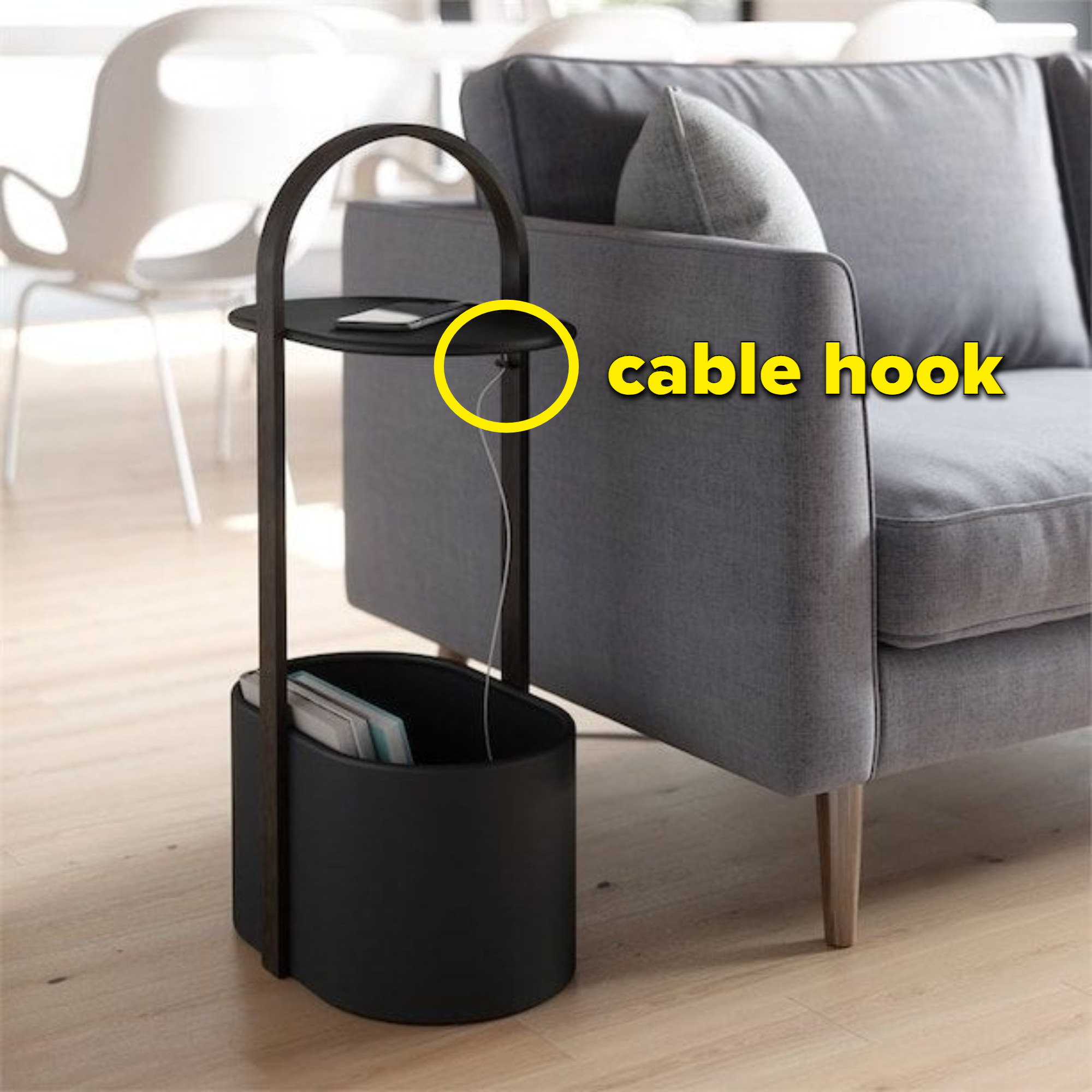 The storage table next to a couch