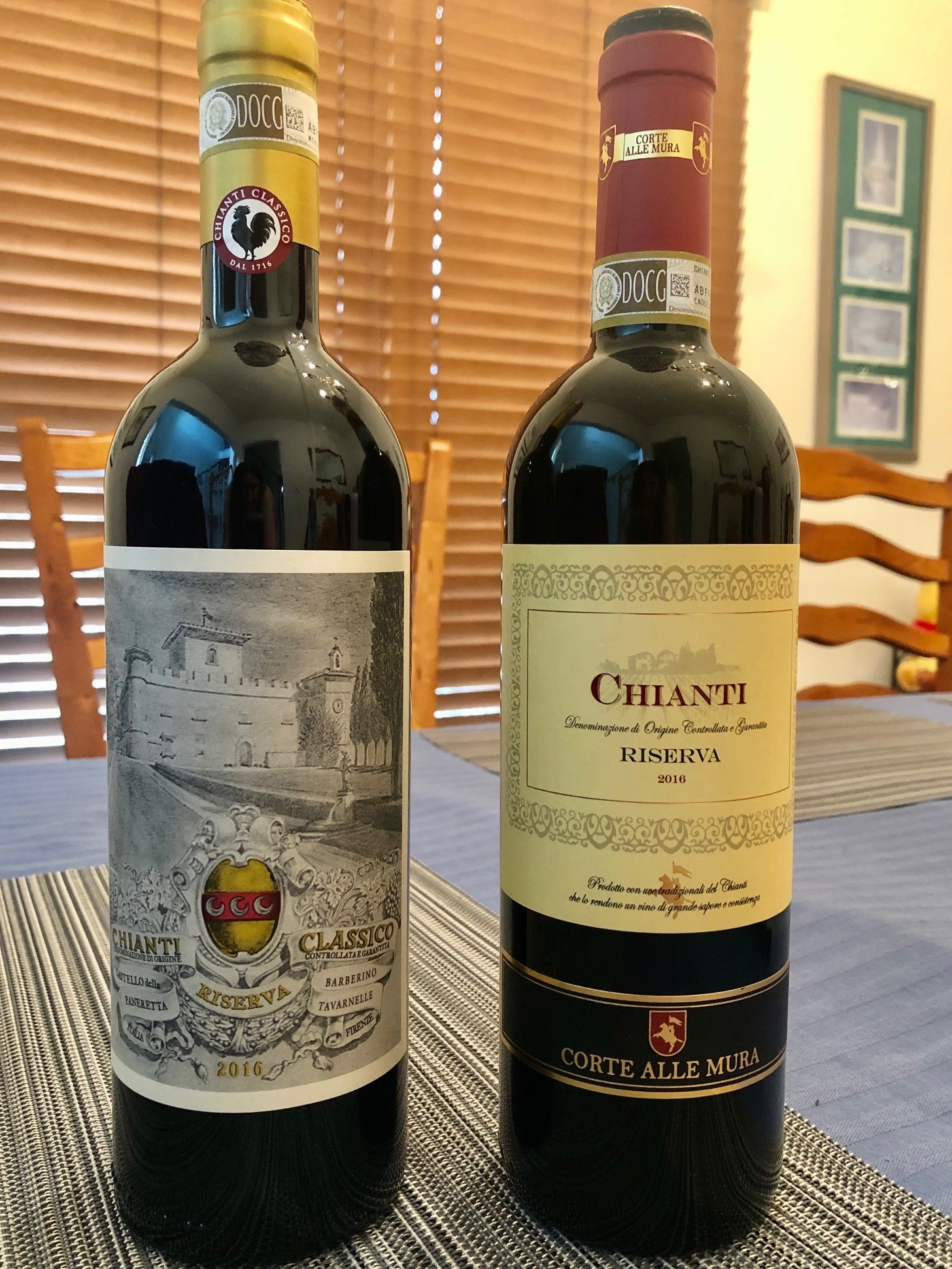 Two bottles of Chianti wine on a table