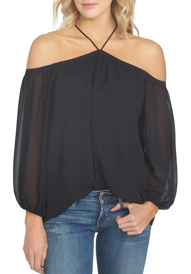 A model wearing the blouse in black