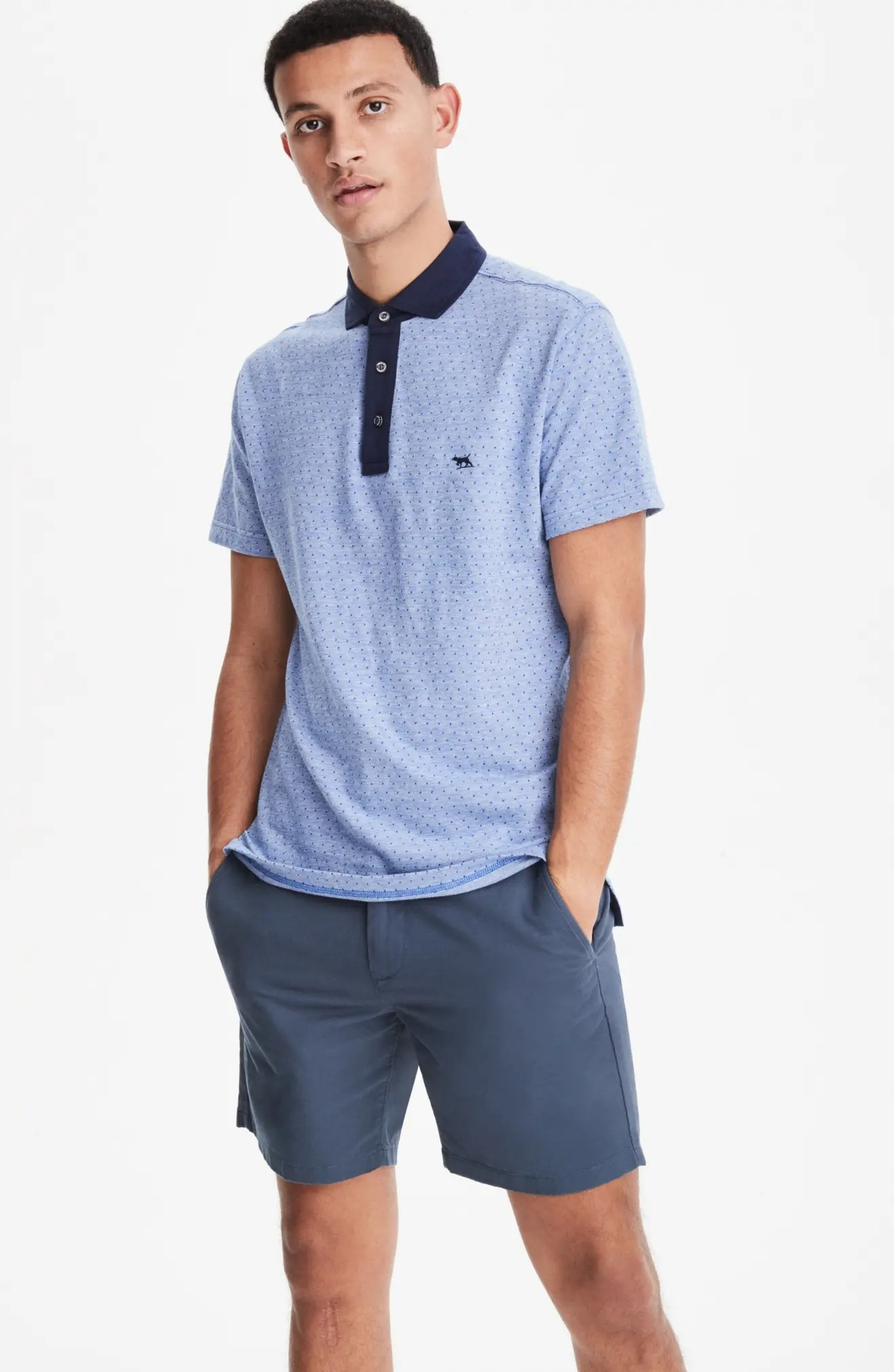 A model wearing the chinos in blue