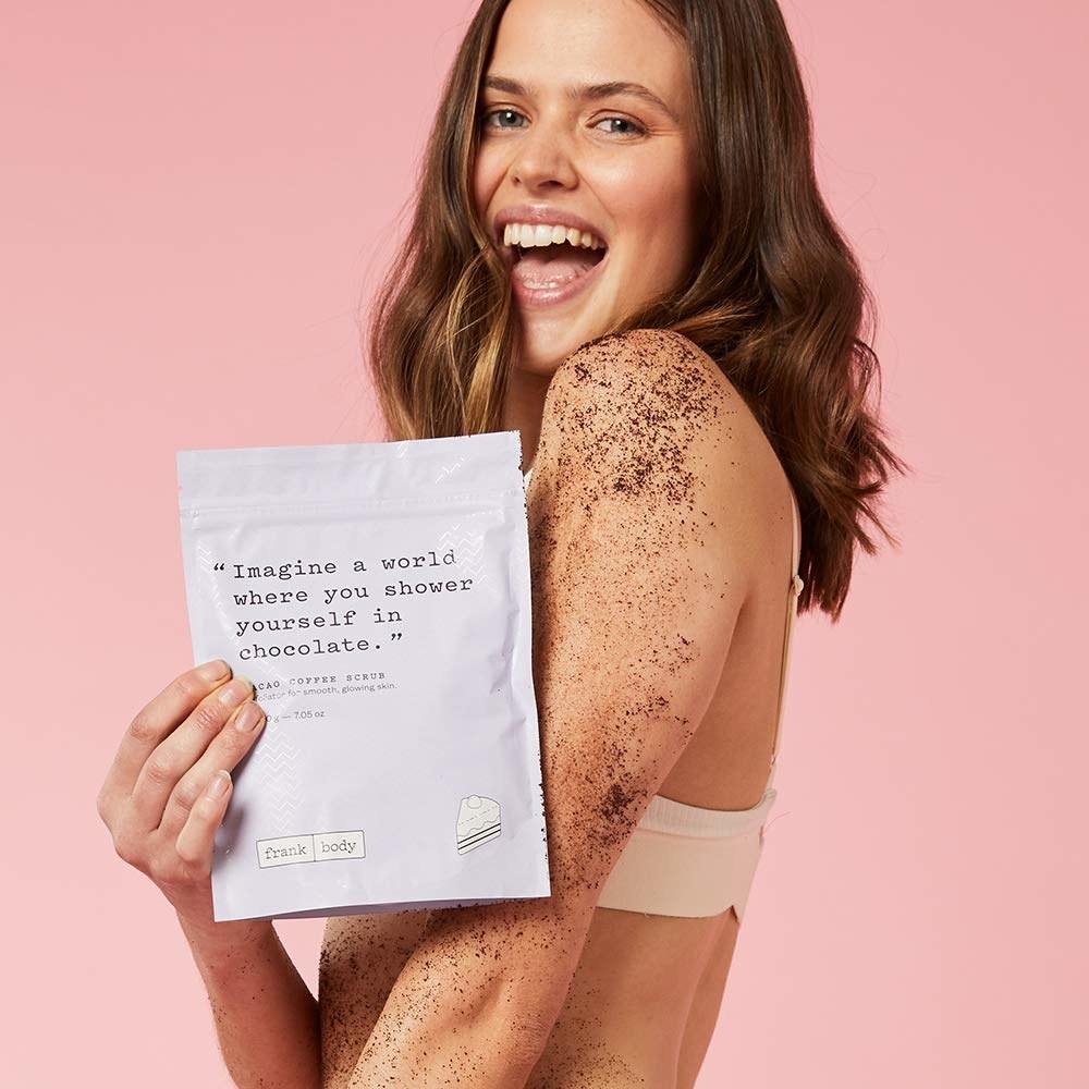 Model holding coffee scrub