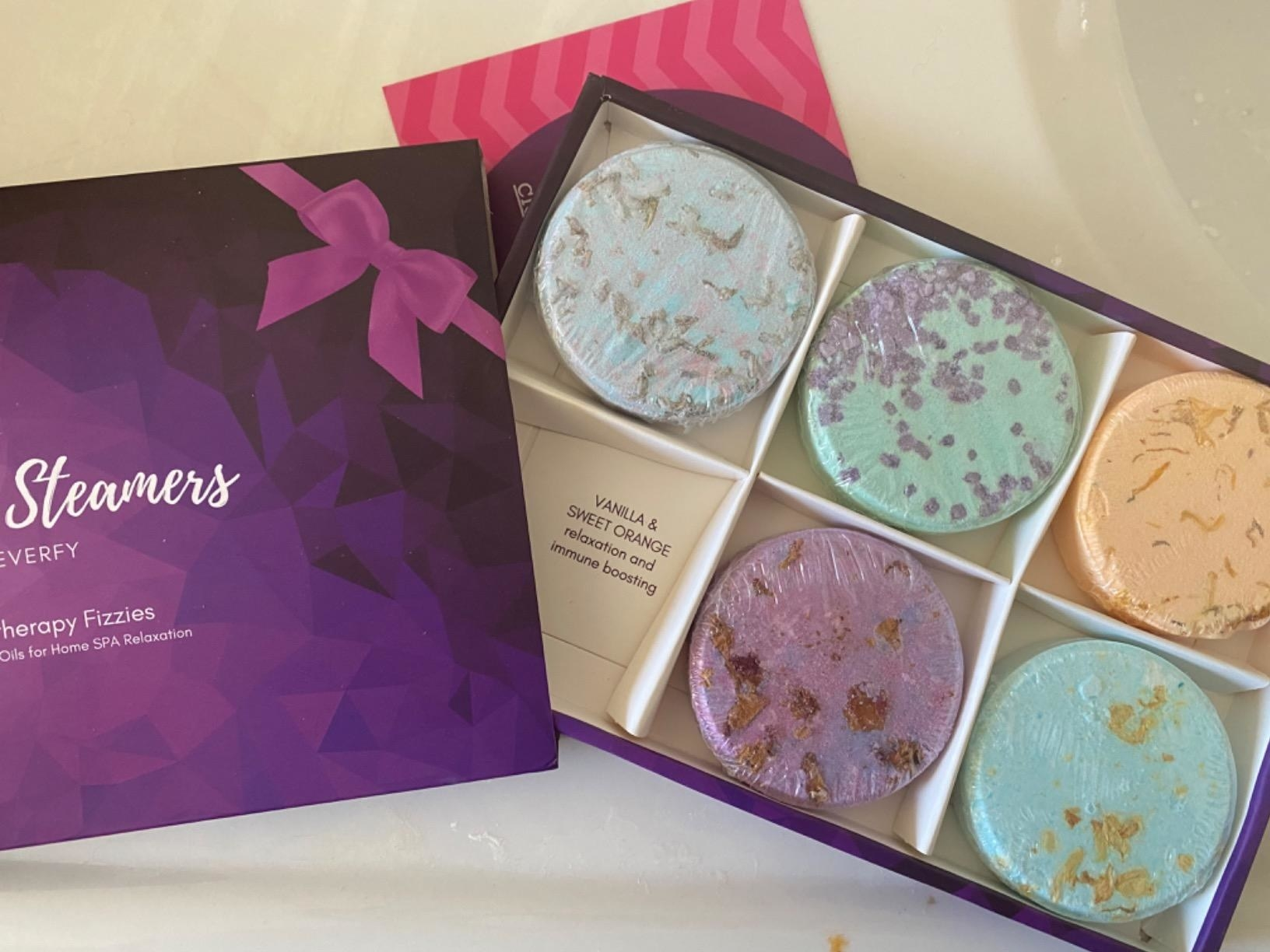 Reviewer set of six bath bombs in box on table