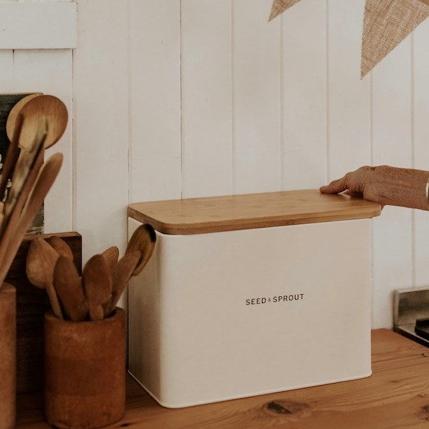 The cute bread box on a wooden counter