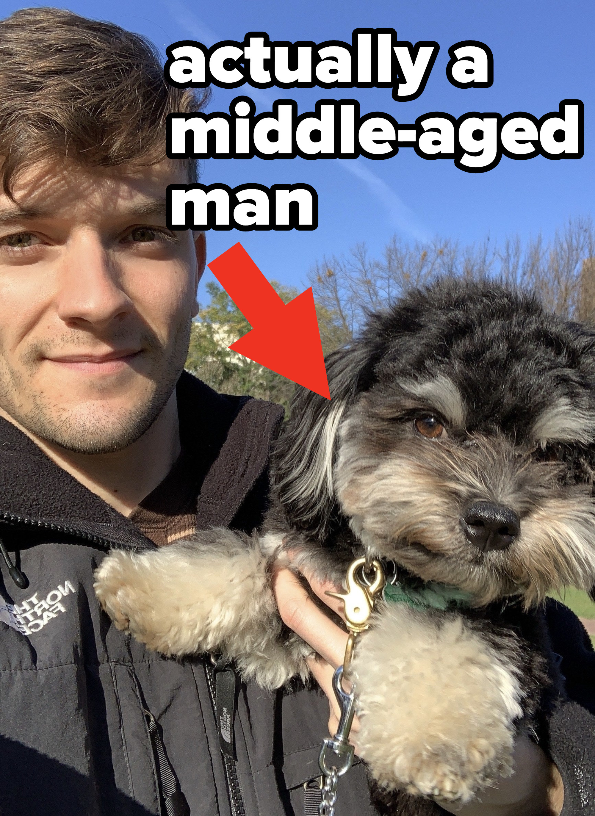 Stephen holding Cosmo with the caption 'actually a middle-aged man'